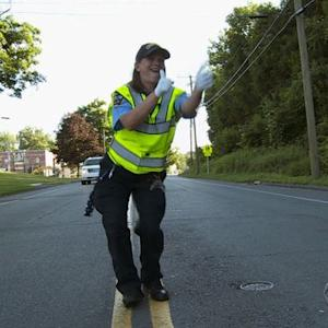 Dancing Connecticut traffic agent chases away sadness with smile