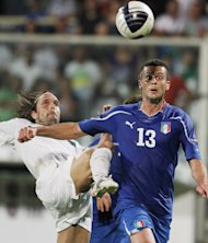 Brazilian born midfielder Thiago Motta of Italy, right, and Slovenia defender Marko Suler battle for the ball during their group C, EURO 2012 qualifying soccer match, at the Artemio Franchi stadium in Florence, Italy, Tuesday, Sept. 6, 2011. (AP Photo/Fabrizio Giovannozzi)