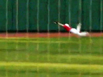 Raw: NC State Player Makes Somersault Catch
