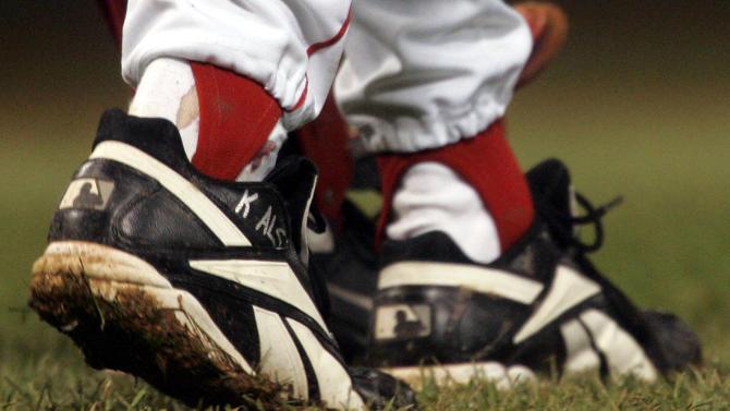 FILE - In this Oct. 24, 2004, file photo, blood appears around the right ankle of Boston Red Sox pitcher Curt Schilling during the sixth inning of Game 2 of baseball's World Series against the St. Louis Cardinals in Boston. Schilling, whose video game company underwent a spectacular collapse into bankruptcy last year, is selling the blood-stained sock he wore during that game. (AP Photo/Elise Amendola, File)