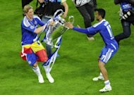 Chelsea's Spanish forward Fernando Torres (L) and Portuguese defender Jose Bosingwa celebrate with the trophy after winning the Champions League final against Bayern Munich on May 19, 2012 at the Allianz Arena stadium in Munich. Chelsea beat Bayern Munich 4-3 on penalties after the game finished 1-1 after extra-time