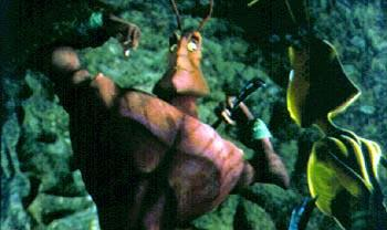 Weaver ( Sylvester Stallone ) shows off for Azteca ( Jennifer Lopez ) in Antz