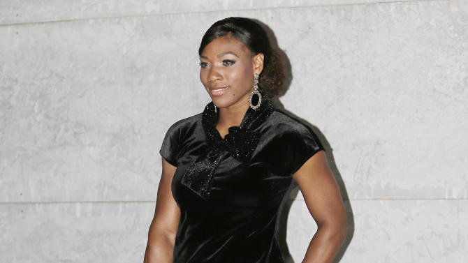 Tennis star Serena Williams, of the United States, poses prior to the start of the Giorgio Armani women's Spring-Summer 2013 fashion collection, during the fashion week in Milan, Italy, Sunday, Sept. 23, 2012. (AP Photo/Antonio Calanni)