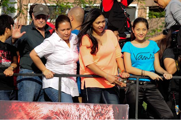 "The cast of the MMFF 2012 entry ""The Strangers"" are seen riding their festival float as it makes its way through the crowd at the 2012 Metro Manila Film Festival Parade of Stars on 23 December 2012.(A"