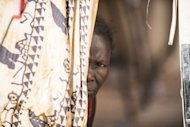 <p>A woman who fled northern Mali looks out from a tent at a camp for internally displaced persons in Sevare, on January 23, 2013. The International Federation of Human Rights Leagues said that in the central town of Sevare at least 11 people were executed in a military camp near the bus station and the town's hospital, citing evidence gathered by local researchers.</p>
