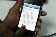 A man browses his Facebook contacts on his mobile phone. Facebook plans to engage in a new type of mobile advertising based on the apps used by consumers, The Wall Street Journal reported Saturday on its website