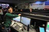 Mars Science Laborator&#39;s lead flight director David Oh speaks to reporters gathered in the Mission Control room at the Jet Propulsion Laboratory in Pasadena on August 2. Attempts by global space agencies since 1960 have resulted in a near 40 percent success rate in sending landers, orbiters or other spacecraft for flybys to Mars. NASA has the best record
