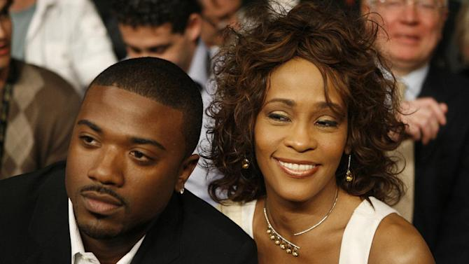 """FILE - In this April 19, 2008 file photo, singers Ray J, left, and Whitney Houston attend the Bernard Hopkins and Joe Calzaghe, of Britain, light heavyweight boxing match at the Thomas & Mack center in Las Vegas. Ray J says he's """"still hurting"""" nearly a month after the death of Whitney Houston.  The singer and sometime reality television star was one of the people who spent time with Houston in her last days.  (AP Photo/Isaac Brekken, file)"""