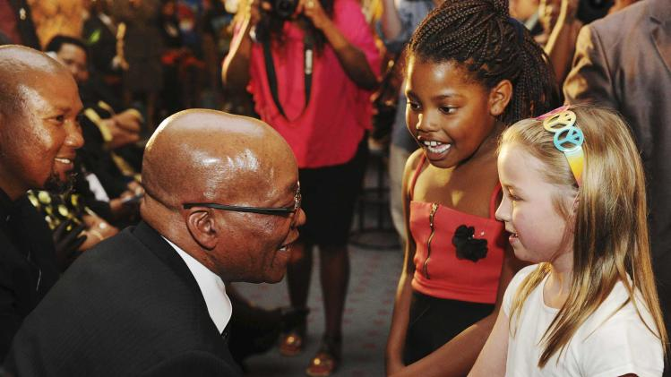 South Africa's President Jacob Zuma speaks with Tanya Garande and Hollie Brown at a church service celebrating and remembering the life of Nelson Mandela in Johannesburg