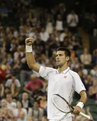 Novak Djokovic of Serbia reacts after winning against Ryan Harrison of the United States during a second round men&#39;s singles match at the All England Lawn Tennis Championships at Wimbledon, England, Wednesday, June 27, 2012. (AP Photo/Kirsty Wigglesworth)
