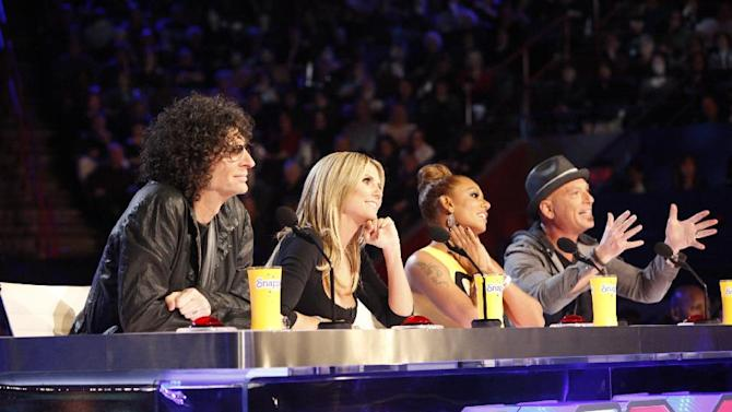 """This March 4, 2013 photo shows the judges for season eight of the talent competition series """"America's Got Talent,"""" from left, Howard Stern, Heidi Klum, Mel B, and Howie Mandel during auditions in New Orleans. NBC's """"America's Got Talent"""" is moving from New Jersey to New York City's Radio City Music Hall. New York Gov. Andrew Cuomo made the announcement Wednesday, April 3.  The eighth season of the popular talent competition will air live from the landmark theater twice a week, starting July 23. (AP Photo/NBC, Skip Bolen)"""
