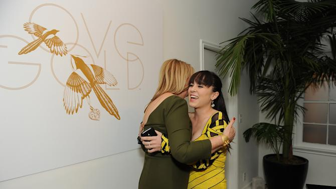 """Sally Morrison, left, and Madeline Fuhrman attend LoveGold/EJAF Celebrate """"How to Survive a Plague"""" at Chateau Marmont on February 22, 2013 in Los Angeles. (Photo by Jordan Strauss/Invision for LoveGold/AP Images)"""