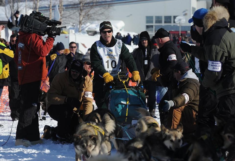 Four-time champion Jeff King hits the trail during the official start of the Iditarod Trail Sled Dog Race on Sunday, March, 4, 2012, in Willow, Alaska. (AP Photo/Anchorage Daily News, Bill Roth)