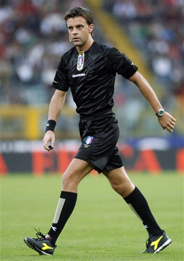 In this Sept. 29, 2007 file photo  Italian referee Nicola Rizzoli walks on the pitch during the Serie A  soccer match between AS Roma and Inter, at Rome's Olympic stadium. It has been announced on Mon