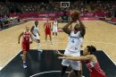 France's Isabelle Yacoubou shoots against Russia during their women's preliminary round Group B basketball match at the Basketball Arena during the London 2012 Olympic Games