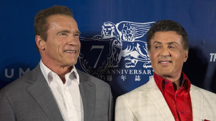 """Schwarzenegger and Stallone arrive on the red carpet for the special screening of """"The Expendables 3"""" in Macau"""