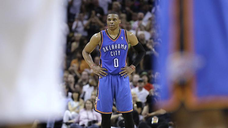 Oklahoma City Thunder's Russell Westbrook (0) watches as teammate Kevin Durant shoots a free throw during the second half of Game 5 of the Western Conference finals NBA basketball playoff series against the San Antonio Spurs, Thursday, May 29, 2014, in San Antonio