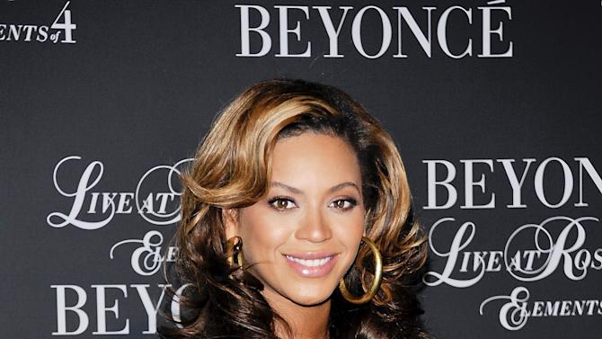 "Singer Beyonce Knowles attends a special screening of ""Beyonce Live At Roseland: The Elements of 4"" at the Paris Theatre on Sunday, Nov. 20, 2011 in New York. (AP Photo/Evan Agostini)"