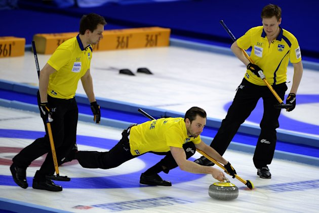 Sweden's skip Sebastian Kraupp (C) delivers a stone during his play against Norway in their bronze medal game at the World Men's Curling Championship on April 8, 2012 in Basel. AFP PHOTO / FABRICE COF