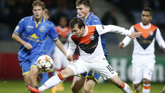 Shakhtar Donetsk's Bernard challenges BATE Borisov's Yablonski during their Champions League Group H soccer match at the Borisov Arena outside Minsk