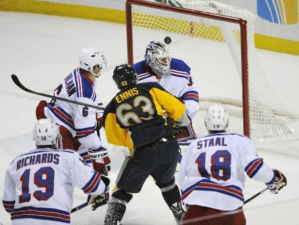 Buffalo Sabres' Tyler Ennis (63) scores against New York Rangers' Henrik Lundqvist (30) as Rangers' Anton Stralman (6) Brad Richards (19) and Marc Staal (18) defend as during the third per