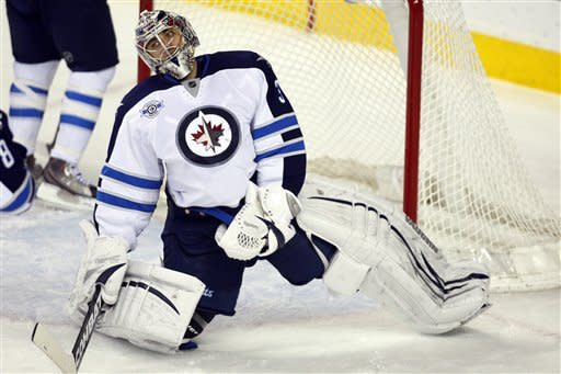 Miikka Kiprusoff helps Flames beat Jets
