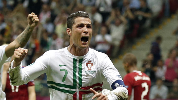 Portugal's Cristiano Ronaldo celebrates after scoring during the Euro 2012 soccer championship quarterfinal match between Czech Republic and Portugal in Warsaw, Poland, Thursday, June 21, 2012. (AP Photo/Armando Franca)