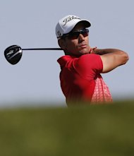Spain's Rafa Cabrera-Bello plays a shot during the first round of the Abu Dhabi Golf Championship in the Emirati capital on January 17, 2013. Justin Rose grabbed a share of the first round lead in the Abu Dhabi Golf Championship on a day when both Rory McIlroy and Tiger Woods struggled to get their seasons into gear
