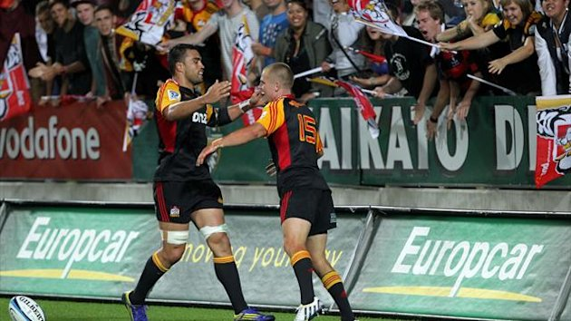 Chief Liam Meesam (L) celebrates with Gareth Anscombe (AFP)