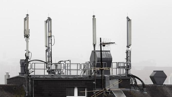 Mobile network antennas are pictured atop the roof of a house in Vienna