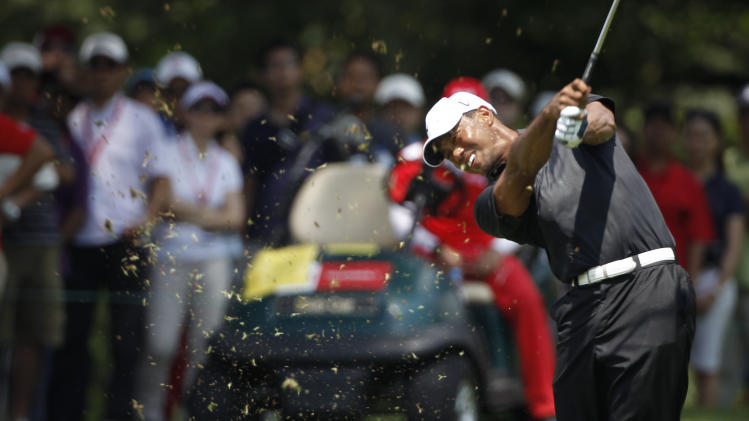 Tiger Woods of the United States watches his shot on the eight hole during round two of CIMB Classic golf tournament at the Mines Resort and Golf Club in Kuala Lumpur, Malaysia, Friday, Oct. 26, 2012. (AP Photo/Vincent Thian)