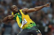 Jamaica&#39;s Usain Bolt celebrates after taking the gold in the men&#39;s 200m final at the athletics event during the London 2012 Olympic Games in London