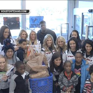 Houston Texans wide receiver Andre Johnson plays Santa Claus for local children