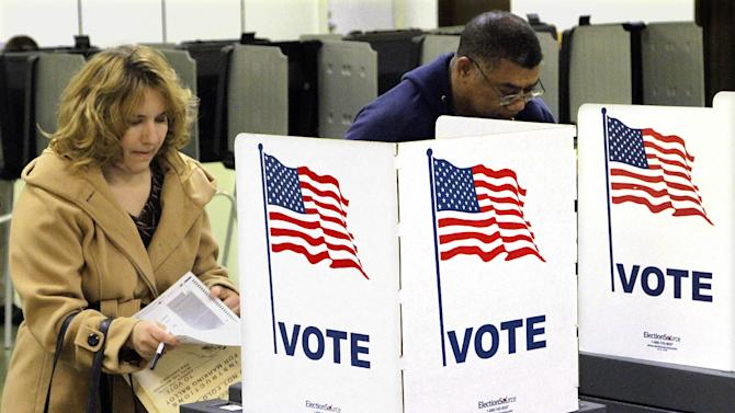 Voters cast their ballots on Election Day Tuesday, Nov. 6, 2012 in Riverton, Ill. (AP Photo/Seth Perlman)