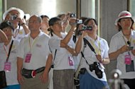 Mainland Chinese tourists take pictures at the Sun Yat-sen Memorial Hall in Taipei, in 2008. Taiwan will double its quota of independent Chinese tourists to allow up to 1,000 visitors a day, the government announced, less than a year after lifting a ban on solo travel from the mainland