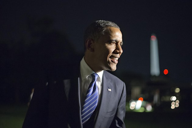 Remarking on the vice presidential debate, President Barack Obama tells reporters, &quot;I think Joe Biden did great. I couldn&#39;t be prouder,&quot; as he returns to the White House in Washington after a day of campaign events in Miami, Thursday night, Oct. 11, 2012. (AP Photo/J. Scott Applewhite)