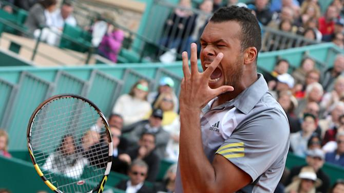 France's Jo-Wilfried Tsonga reacts during the semifinal match of the Monte Carlo Tennis Masters tournament in Monaco against Spain's Rafael Nadal, Saturday, April 20, 2013. (AP Photo/Claude Paris)