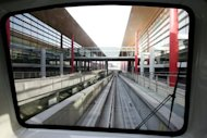 The light rail train undergoes testing at Beijing&#39;s Terminal Three at Beijing Capital International Airport. China has approved a massive infrastructure package worth more than 1.0 trillion yuan ($158 billion), state media said, as the government seeks to boost the flagging economy