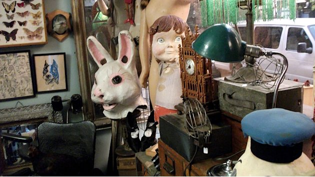 "Collection of items including a giant bunny head and clock as seen on ""Oddities."""