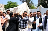 The body of former Libyan oil minister Shukri Ghanem is carried during his funeral in the Libyan capital Tripoli in May 2012. Ghanem, whose body was recovered from the Danube river in April, suffered a heart attack before drowning, an official said Tuesday