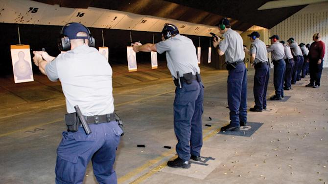 This handout photo provided by the Federal Law Enforcement Training Center (FLETC), taken in Feb. 2010, shows training activities at the indoor range Glynco, Ga. Yes, it's true, the government is buying ammo big time. No, it's not to take up arms against the people, as an online conspiracy buzz has it. The Homeland Security Department is ordering more than 1.6 billion rounds over the next four or five years, roughly the equivalent of five bullets for every person in the U.S. But the cache is for training agents and regular law enforcement, nothing sinister, officials say. (AP Photo/FLETC)