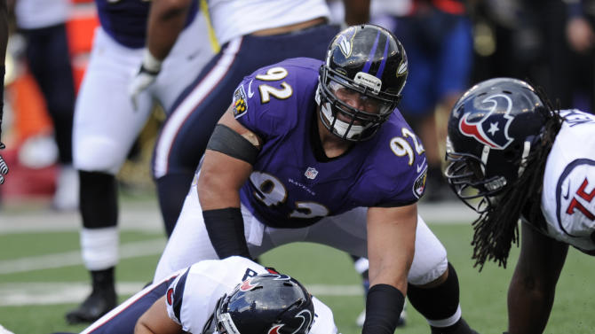 Baltimore Ravens defensive tackle Haloti Ngata (92) lifts himself off of Houston Texans quarterback Matt Schaub after sacking him in the first half of an NFL football game Sunday, Sept. 22, 2013, in Baltimore. (AP Photo/Nick Wass)