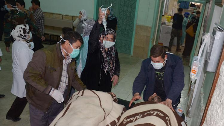 "In this photo released by the Syrian official news agency SANA, Syrian victims who suffered an alleged chemical attack at Khan al-Assal village according to SANA, are covered by blankets as they receive treatment, at a hospital in Aleppo, Syria, Tuesday March 19, 2013. Syria's information minister says a chemical weapon fired by rebels on a village in the north of the country is the ""first act"" by the opposition interim government announced in Istanbul. He says 16 people were killed and 86 wounded in the attack. Rebels have denied the accusation and say regime forces fired the weapon. (AP Photo/SANA)"