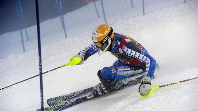 Andre Myhrer of Sweden in action during the first run of the men's World Cup slalom in Levi, Finland Sunday Nov. 11, 2012. Andre Myhrer of Sweden on Sunday clocked the fastest time in the first run of a men's World Cup slalom, taking a narrow lead over defending overall champion Marcel Hirscher.   (AP Photo/Lehtikuva/Markku Ulander)   FINLAND OUT