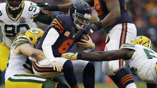 Chicago Bears quarterback Jay Cutler (6) is sacked by Green Bay Packers linebacker Clay Matthews, left, in the second half of an NFL football game in Chicago, Sunday, Dec. 16, 2012. At right is Packers  linebacker Dezman Moses. The Packers won 21-13 to clinch the NFC North division title. (AP Photo/Nam Y. Huh)