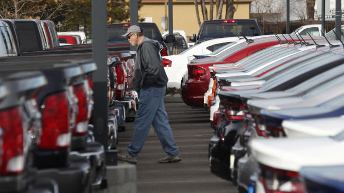 FILE - In this Sunday, Jan. 20, 2013 file photo, a buyer moves between rows of 2013 Ram pickup trucks and Dart sedans at a Dodge dealership in Littleton, Colo. Chrysler's U.S. sales rose 11 percent in May, a sign that auto sales rebounded from a slight dip in April and will continue to boost the U.S. economy. Ram pickup truck sales were strong, up 22 percent over a year ago to almost 32,000. (AP Photo/David Zalubowski, File)