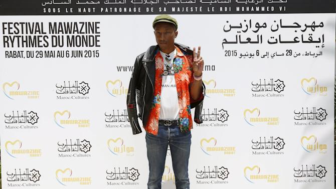 Singer Pharrell Williams poses during a photocall at the 14th Mawazine World Rhythms International Music Festival in Rabat