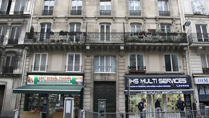 """View of the building where three Kurdish women, including one of the founders of a militant group battling Turkish troops since 1984, were """"executed"""" in Paris, Thursday, Jan. 10, 2013. Three Kurdish women, including one of the founders of a militant group battling Turkish troops since 1984, were """"executed"""" at a Kurdish center in Paris, the interior minister said Thursday. The news prompted angry crowds of Kurds to flood into the area. It was not immediately clear who killed the women, who belonged to the Kurdistan Workers Party, or PKK, a group that Turkey and its Western allies, including the United States and the European Union, consider a terrorist organization. (AP Photo/Christophe Ena)"""