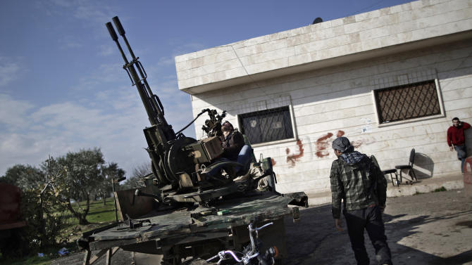 FILE - In this Friday, Dec. 14, 2012 file photo, a Syrian rebel checks an anti-aircraft weapon, in Maaret Misreen, near Idlib, Syria. America's Arab allies have dramatically stepped up weapon supplies to Syrian rebels in preparation for a push on the capital Damascus, the main stronghold of President Bashar Assad, officials and Western military experts say, with one official saying airlifts to neighboring Jordan and Turkey have doubled the past month. The U.S. and other Western governments are involved to channel the flow toward more secular fighters, they say. The influx appears to be boosting a rebel drive to seize supply routes from the border with Jordan to Damascus. (AP Photo/Muhammed Muheisen, File)