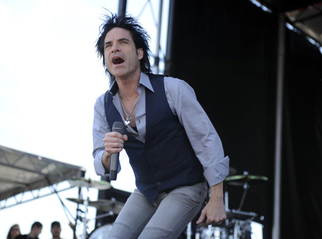 FILE - In this May 21, 2011 file photo, Patrick Monahan of the rock group Train performs at Pimlico Race Course in Baltimore. Train, Christina Aguilera, Michael Buble, and Dave Matthews are among the acts helping Special Olympics celebrate the 25th anniversary of its &quot;A Very Special Christmas&quot; album series. Two albums will be released Oct. 16 to celebrate the partnership, which has raised more than $100 million for Special Olympics. (AP Photo/Nick Wass, File)